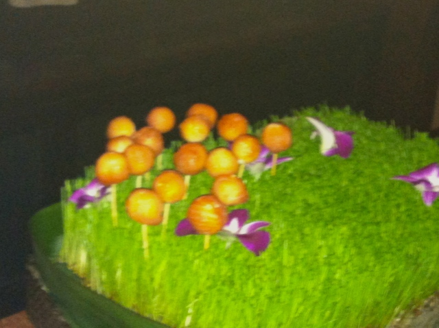 A garden with flowers made of smoked salmon and cream cheese.