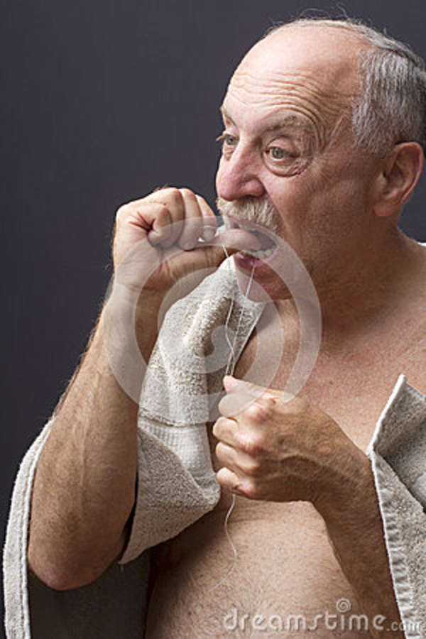 older-man-flossing-28865423